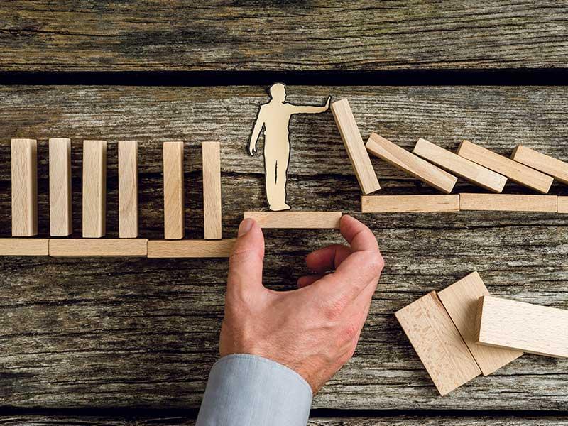Wooden dominos falling