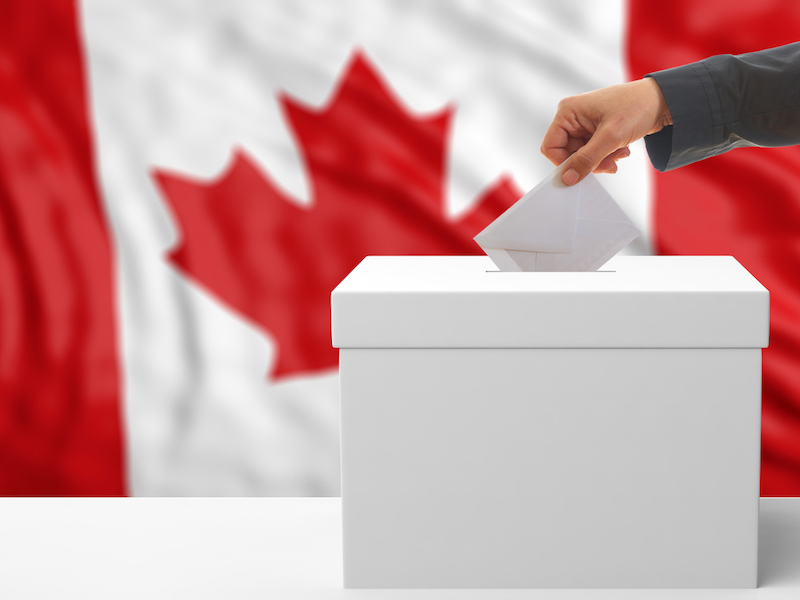 Voter on a Canada flag background.