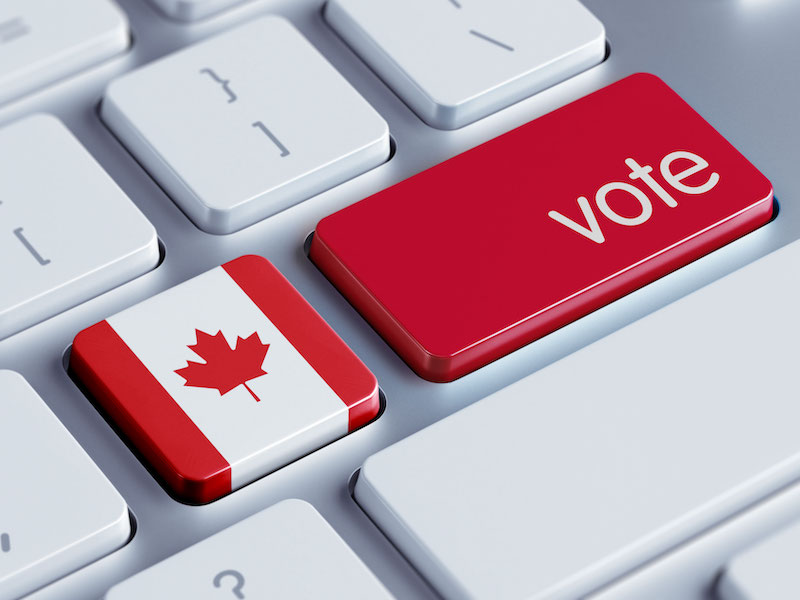 Canadian voting appeal on computer keyboard