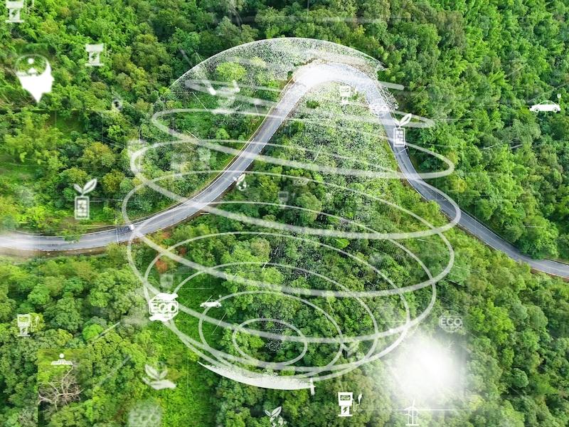 Green landscape with sustainability symbols