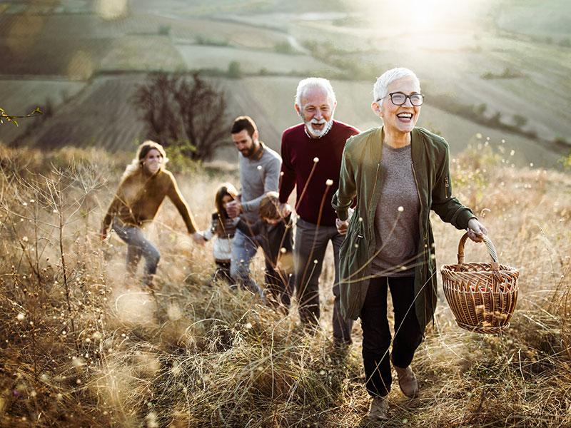 Multi-generational family, happily hiking