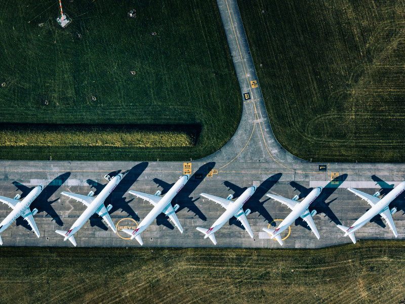 A long line of parked airplanes